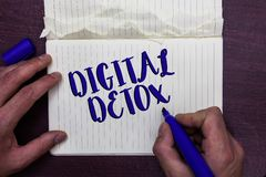 Writing note showing Digital Detox. Business photo showcasing Free of Electronic Devices Disconnect to Reconnect Unplugged Man hol. Ding marker notebook page royalty free stock photo