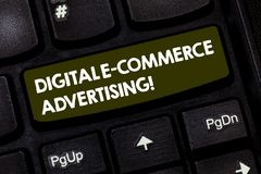 Writing note showing Digital E Commerce Advertising. Business photo showcasing Trading of goods and services using the. Web Keyboard key Intention to create stock photography