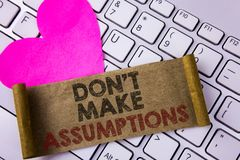 Writing note showing Do not Make Assumptions. Business photo showcasing predict events future without clue Alternative Facts writ. Ten Folded Cardboard Paper royalty free stock photos