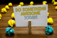 Writing note showing Do Something Awesome Today. Business photo showcasing Make an incredible action motivate yourself Written not. Epad stand with paperclip Royalty Free Stock Image