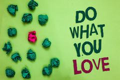 Writing note showing Do What You Love. Business photo showcasing Make enjoyable things do activities with motivation Olive color f. Loor scattered some green stock images