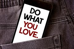 Writing note showing Do What You Love.. Business photo showcasing Positive Desire Happiness Interest Pleasure Happy Choice Words w. Ritten black Phone white royalty free stock photo