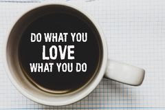 Writing note showing Do What You Love What You Do. Business photo showcasing Make things that motivate yourself Passion Coffee mug. With black coffee floating royalty free stock images