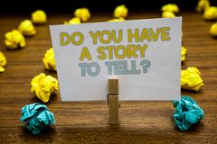 Writing note showing Do You Have A Story To Tell question. Business photo showcasing Storytelling Memories Tales Experiences Writt. En notepad stand with royalty free stock images