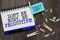 Writing note showing Don t not Be Busy. Be Productive. Business photo showcasing Work efficiently Organize your schedule time Diff. Erent paperclip on woody stock photos