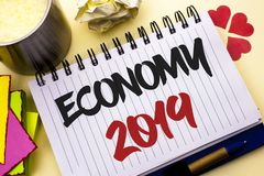 Writing note showing  Economy 2019. Business photo showcasing Financial Currency Growth Market Earnings Trade Money written on Not. Writing note showing  Economy Stock Images