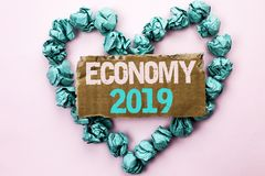Writing note showing  Economy 2019. Business photo showcasing Financial Currency Growth Market Earnings Trade Money written on Tea. Writing note showing  Economy Stock Photos