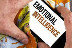Writing note showing  Emotional Intelligence. Business photo showcasing Capacity to control and be aware of personal emotions writ. Ten Mobile Screen holding by Royalty Free Stock Images