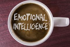 Writing note showing Emotional Intelligence. Business photo showcasing Capacity to control and be aware of personal emotions writ. Ten Coffee in White Cup the royalty free stock image
