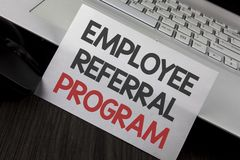 Writing note showing Employee Referral Program. Business photo showcasing strategy work encourage employers through prizes writte. N White Sticky Note Paper stock photo
