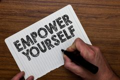 Writing note showing Empower Yourself. Business photo showcasing taking control of life setting goals positive choices Man holdin. G marker notebook paper Royalty Free Stock Photos