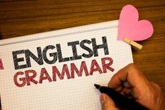 Writing note showing English Grammar. Business photo showcasing Language Knowledge School Education Literature Reading Man holdin