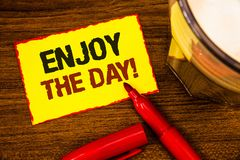 Writing note showing  Enjoy The Day Motivational Call. Business photo showcasing Enjoyment Happy Lifestyle Relaxing Time Words yel. Low paper note red border Royalty Free Stock Photography