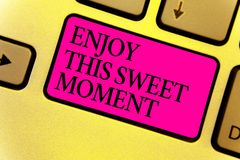 Writing note showing Enjoy This Sweet Moment. Business photo showcasing encouraging someone to love his life timeline Keyboard pin. K key Intention computer stock photo