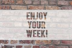 Writing note showing Enjoy Your Week. Business photo showcasing Best wishes for the start of weekdays have great days. Brick Wall art like Graffiti motivational stock image