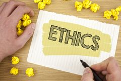Writing note showing  Ethics. Business photo showcasing Maintaining equality balance among others having moral principles written. Tear Notebook Paper wooden Stock Photos
