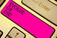 Writing note showing Evolve Or Die. Business photo showcasing Necessity of change grow adapt to continue living Survival Keyboard. Pink key Intention computer stock photography