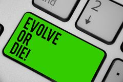 Writing note showing Evolve Or Die. Business photo showcasing Necessity of change grow adapt to continue living Survival Keyboard. Green key Intention computer stock photography