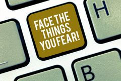 Writing note showing Face The Things You Fear. Business photo showcasing Have courage to confront scary situations. Keyboard Intention to create computer royalty free stock photography