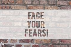 Writing note showing Face Your Fears. Business photo showcasing Have the courage to overcome anxiety be brave fearless. Brick Wall art like Graffiti stock images