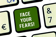 Writing note showing Face Your Fears. Business photo showcasing Have the courage to overcome anxiety be brave fearless. Keyboard key Intention to create stock photo