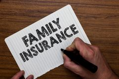Writing note showing Family Insurance. Business photo showcasing paying a partial or full health care for relatives Man holding m stock photography