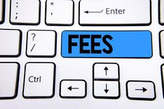 Writing note showing Fees. Business photo showcasing Online creative agency charges product components hourly costs written on Blu royalty free stock photo