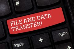 Writing note showing File And Data Transfer. Business photo showcasing Transferring information online by the internet. Keyboard key Intention to create royalty free stock photo