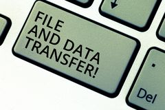 Writing note showing File And Data Transfer. Business photo showcasing Transferring information online by the internet. Keyboard key Intention to create stock photography