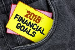Writing note showing  2018 Financial Goals. Business photo showcasing New business strategy earn more profits less investment writ. Ten Yellow Sticky Note Paper Stock Photos