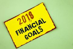 Writing note showing  2018 Financial Goals. Business photo showcasing New business strategy earn more profits less investment writ. Ten Yellow Colored Sticky Stock Photos