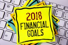 Writing note showing  2018 Financial Goals. Business photo showcasing New business strategy earn more profits less investment writ. Ten Yellow Sticky note paper Stock Photo