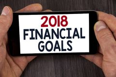 Writing note showing  2018 Financial Goals. Business photo showcasing New business strategy earn more profits less investment writ. Ten Mobile Phone Screen Royalty Free Stock Photos