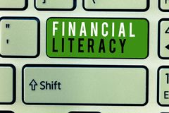 Writing note showing Financial Literacy. Business photo showcasing Understand and knowledgeable on how money works.  stock photos