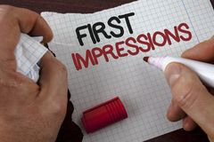 Writing note showing  First Impressions. Business photo showcasing Encounter presentation performance job interview courtship writ. Ten by Man Tear Notebook Stock Photos