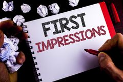 Writing note showing  First Impressions. Business photo showcasing Encounter presentation performance job interview courtship writ. Ten by Man Notepad holding Stock Images