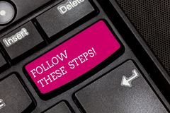 Writing note showing Follow These Steps. Business photo showcasing go through action plan or idea with calculations. Keyboard key Intention to create computer stock photography