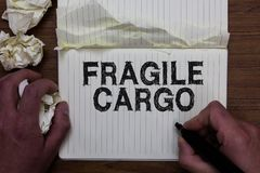 Writing note showing Fragile Cargo. Business photo showcasing Breakable Handle with Care Bubble Wrap Glass Hazardous Goods Man hol. Ding marker notebook crumpled stock image