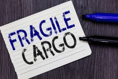 Writing note showing Fragile Cargo. Business photo showcasing Breakable Handle with Care Bubble Wrap Glass Hazardous Goods Noteboo. K Paper Reminder royalty free stock image