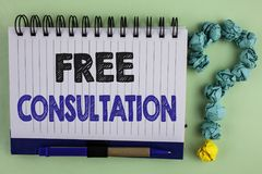 Writing note showing  Free Consultation. Business photo showcasing asking someone expert about confusion inquiry Get advice writte. N Notebook the plain Royalty Free Stock Image