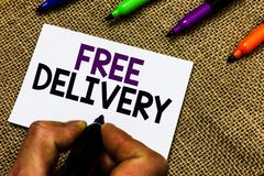 Writing note showing Free Delivery. Business photo showcasing Shipping Package Cargo Courier Distribution Center Fragile Man hand. Holding marker white paper royalty free stock images
