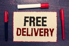 Writing note showing Free Delivery. Business photo showcasing Shipping Package Cargo Courier Distribution Center Fragile Open note. Book page markers royalty free stock photo