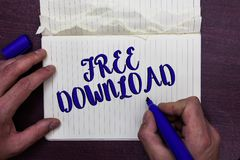Writing note showing Free Download. Business photo showcasing Key in Transfigure Initialize Freebies Wireless Images Man holding m. Arker notebook page crumpled royalty free stock image