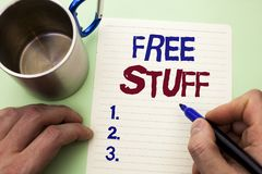 Writing note showing Free Stuff. Business photo showcasing Complementary Free of Cost Chargeless Gratis Costless Unpaid written b. Y Man Notebook Paper Holding royalty free stock photos