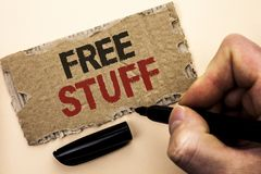 Writing note showing Free Stuff. Business photo showcasing Complementary Free of Cost Chargeless Gratis Costless Unpaid written b. Y Man Holding Marker tear royalty free stock photo