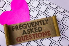 Writing note showing  Frequently Asked Questions. Business photo showcasing most common inquiries Informations Help Guide written. Folded Cardboard Paper Piece Royalty Free Stock Photo