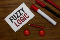 Writing note showing Fuzzy Logic. Business photo showcasing checks for extent of dirt and grease amount of soap and water White pa. Per markers wooden background royalty free stock image