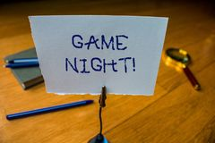 Writing note showing Game Night. Business photo showcasing usually its called on adult play dates like poker with. Writing note showing Game Night. Business stock photo