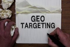 Writing note showing Geo Targeting. Business photo showcasing Digital Ads Views IP Address Adwords Campaigns Location Man holding. Marker notebook crumpled royalty free stock image