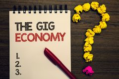 Writing note showing The Gig Economy. Business photo showcasing Market of Short-term contracts freelance work temporary written on. Notepad red pen yellow paper stock photos
